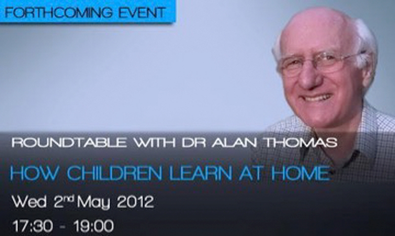 Poster of a man with writing saying that it's Dr Alan Thomas.